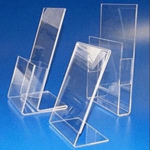 Display de acrílico e suportes de folders.